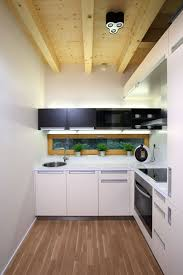 Modular Kitchen In Small Space Space Saving Ideas For Small Kitchens With White Cabinetry And
