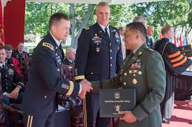 war college provides strategic advantage for officers of all  romeo s brawner of the accepts his war college diploma and congratulations from gen dan allyn vice chief of staff of the