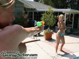 Casey Parker has a naked super soaker water fight in the back yard.