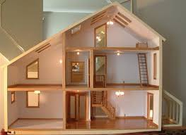 this is how my husband would build a doll house. all out- including  windows, skylights, and working ceiling fan lights.
