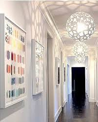 buy pendant lighting. three sparkling white coral pendant lights lining this beautiful hallway make us think of spring click image for where to buy lighting e