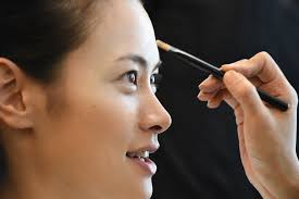 an tokyo anese fashion model rei hamada gets her makeup done for the 2016 spring summer collection by sansai saito and jotaro saito in the tokyo