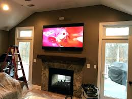 hanging tv over fireplace installing into brick fireplace mounted over surround sound installation hang above stone hanging tv over fireplace