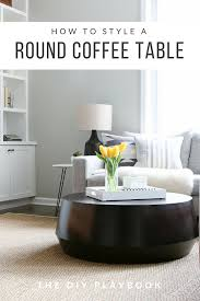 styling a round coffee table can be tricky and there are many things to keep in