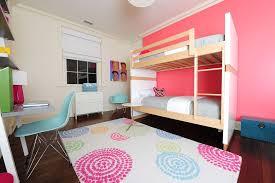 pink aztec rug modern kids also accent wall area rug bedroom bunk beds dark floor girls room kids room modern icons pink accent pink wall shared bedroom
