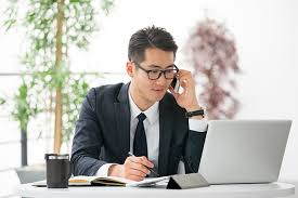 Use Tablet As Phone Young Asian Businessman Using Tablet Mobile Phone In The