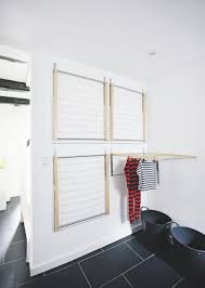 The wall-mounted drying racks from Ikea are convenient because they do not  take up