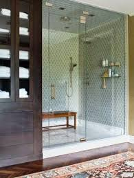large shower bench in shower tiles rug hardwood floors in the bathroom