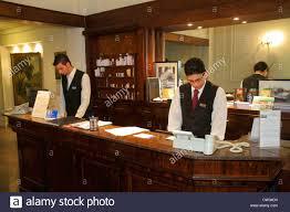 buenos aires argentina avenida de mayo hotel mundial hospitality lodging business front desk hispanic man clerk