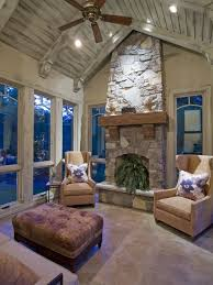 Example of a mountain style sunroom design in Minneapolis with a stone  fireplace and a standard