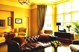 Paint Colors For Living Room With Dark Brown Furniture Yellow Gold Paint Color Living Room Living Room Design Ideas