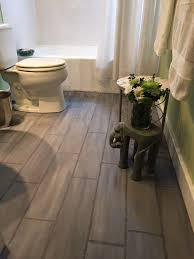 when you re so over your boring bathroom floor this might be the most inexpensive way to dramatically transform it