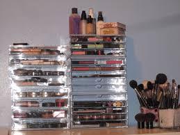 white polished metal makeup storage drawers and black plastic