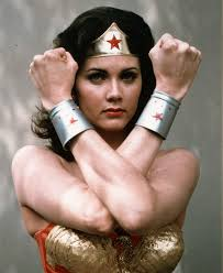 wonder woman is awesome she has these amazing bracelets that help her block blaster bolts and totally protect her even though she barely wears anything