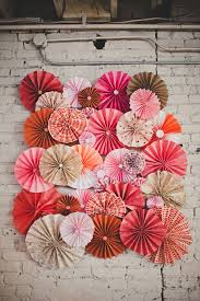 diy paper pinwheel wall from our wedding handmade with paper from local art s