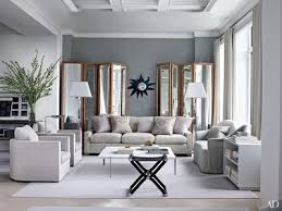 Image Entertaining In This Manhattan Apartment Designed By Shelton Mindel Assoc Bespoke Folding Screens Flank 1950s Line Vautrin Mirror In The Living Room Architectural Digest Inspiring Gray Living Room Ideas Architectural Digest