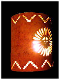 southwestern style sunface and step cutout exterior or interior wall sconce pinned by pin4