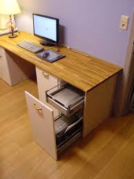 IKEA Hackers: work station from kitchen base cabinets. Very clever: drawers  for printer  Custom Computer DeskCustom ...