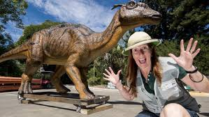 dinosaur keeper jen allan with one of 19 dinosaurs making their way to perth