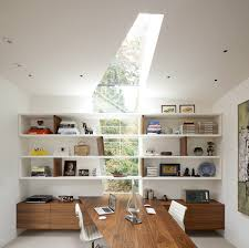 modern home office. Two Individual Spaces Have Been Created In This Unusual Home Office Layout.  It Is Divided By A Centrally Situated Asymmetrical Desk That Mirrors Unique Modern