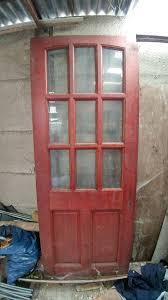 brown wooden front door with 6 glass panels