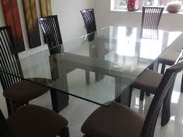 photo of a 15mm thick glass table top fitted to stone legs