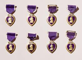 history trivia question who received the most purple heart medals 9 during his
