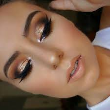 eyes are saddle folie brown script and carbon in crease honey love on lid liner is creme color