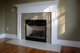 interior white tile fireplace base ideas connected by white fireplace leg and black metal fire