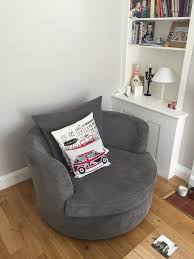 dfs vision large swivel chair in grey good condition 2 years old