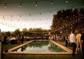 outdoor string lighting for wedding reception with square swimming pool designs