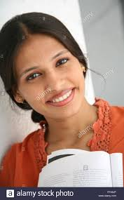 South Asian Indian young lady holding book MR#687 Q