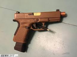 glock 19 gen 3 factory fde slide and frame the cerakote on the slide is scratched from carry and use still in great shape