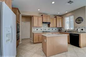 traditional u shaped kitchen with brown cabinetry a yes island and a combination of black appliances and white appliances source zillow digs