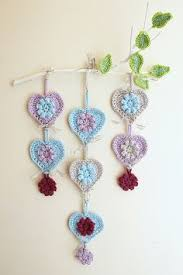 crocheted hearts wall hanging on branch tutorial teresa