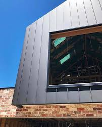 traditionally modern single lock standing seam with concealed capping detail in pvdf satin black
