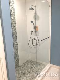 frameless inline enclosure with chrome hardware and a 24 towel bar