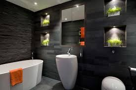 Contemporary black tile and slate tile freestanding bathtub idea in London  with a pedestal sink and