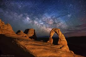 an april milk way rises behind delicate arch arches national park utah foreground illuminated by low level landscape lll lighting