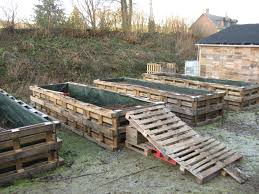 Old Pallets Used To Make A Raised Garden Cool Now I Don T Have To