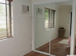 white framed mirrored wardrobe sliding doors after