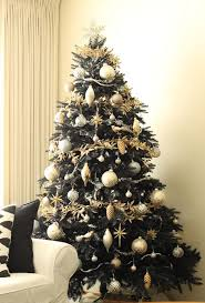 Photo by Treetopia - Browse home design ideas. Garland Before adding  ornaments to your black Christmas tree ...