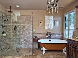 master bathroom with chandelier and glass shower