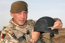 British soldier Leon Wilson shows off a bullet hole in his helmet. Updated 25 May 2011, 5:30pmWed 25 May 2011, 5:30pm. Unscathed: Leon Wilson shows off the ... - 1658334-3x2-940x627