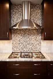kitchen design naperville. the homeowner selected this stylish contemporary stainless steel hood. and design followed. behind hood is glass tile mosaic in soft grays kitchen naperville