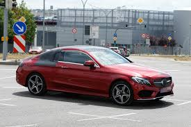 In amg trim, it's risen above and beyond bavarian levels of handling. Spyshots 2016 Mercedes C Class Coupe Almost Undisguised In Red Paint Signals Debut Autoevolution