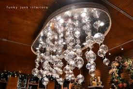 funky lighting. christmas ornament chandelier by milner village garden centre featured on funky junk interiors lighting
