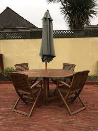 wooden garden table chairs and parasol