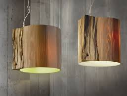 lighting wooden lights the wise one wood log pendant light by ieva kaleja for