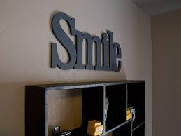 Smile wood letters. Font: Century Schoolbook CNBT. Letter Connect.